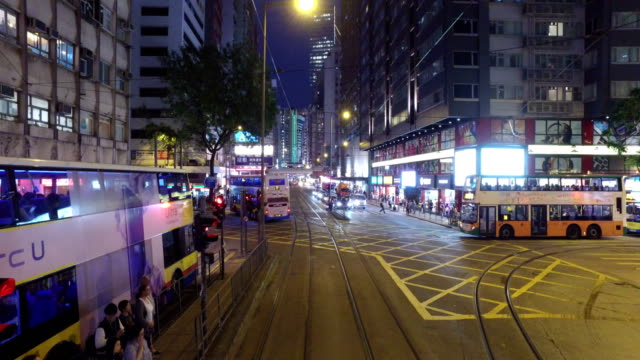 tramway in hong kong central business district at night - tram point of view stock videos and b-roll footage