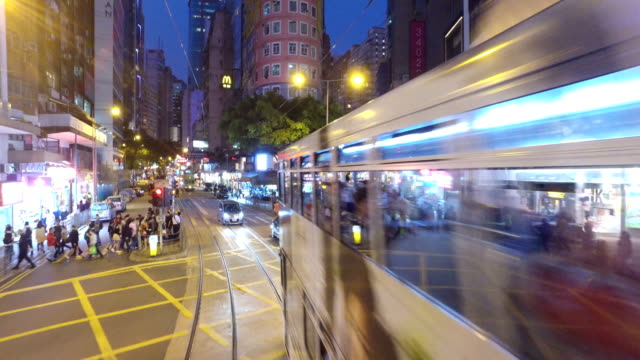 tramway in hong kong central business district at night - tram stock videos & royalty-free footage