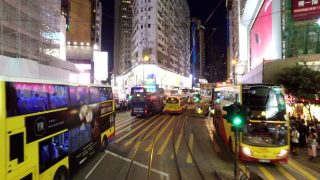 tramway in hong kong central business district at night - hong kong island stock videos & royalty-free footage