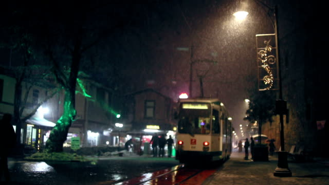Tramway passing by in a rainy night