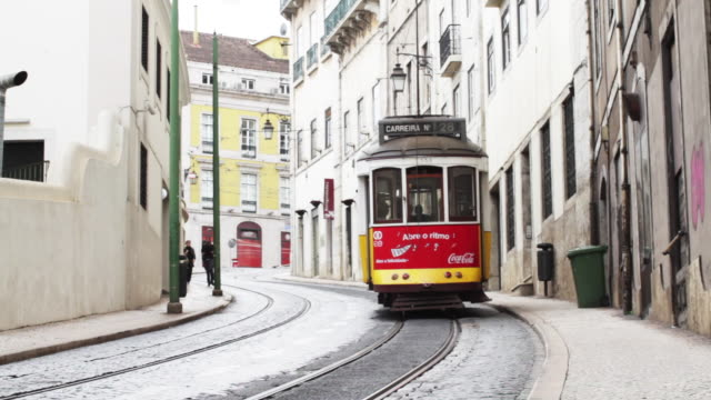 tramway travels up narrow street - traditionally portuguese stock videos & royalty-free footage