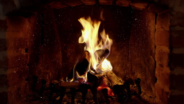 8k tranquil, crackling fire and ash in brick fireplace, real time with audio - log stock videos & royalty-free footage