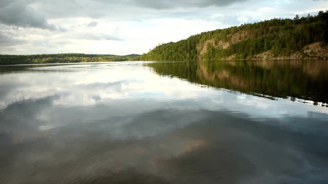 tranquil lake with reflection - ontario canada stock videos & royalty-free footage