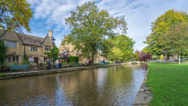 a tranquil scene of bourton-on-the-water with river windrush in cotswolds, gloucestershire, england - 4k time-lapse - cotswolds stock videos & royalty-free footage