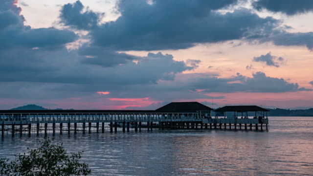 tranquil sea with jetty at sunset, time lapse video - jetty stock videos & royalty-free footage