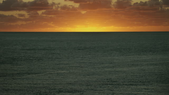 tranquil seascape with golden sunrise - idyllic stock videos & royalty-free footage