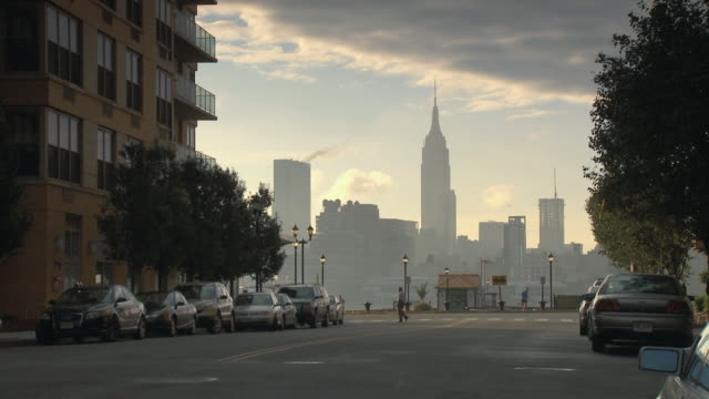 WS Tranquil street scene with Empire State Building in skyline shot, viewed from 14th street in Hoboken / New York City, USA