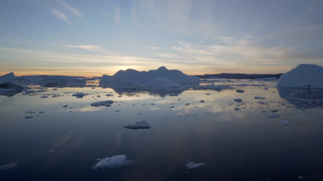 tranquil view of disko bay against sky during sunset - inlet stock videos & royalty-free footage