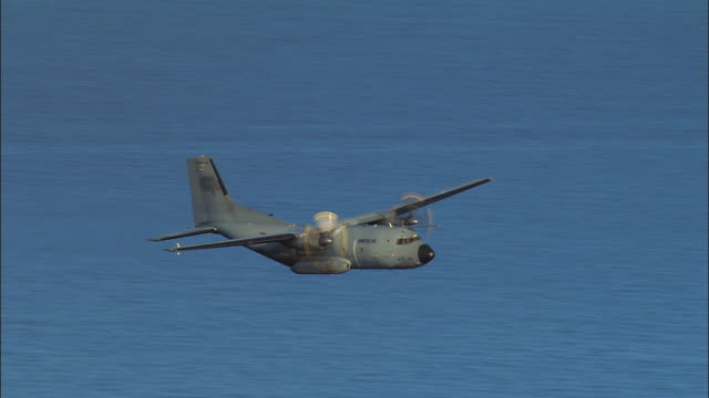 AERIAL C-160 Transall, a French military plane, flying over water/ Cote d'Azur, France