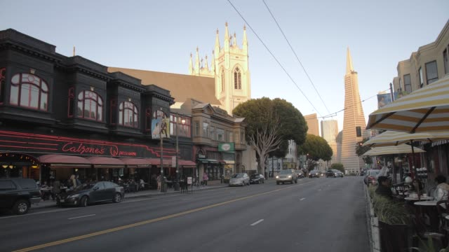 transamerica pyramid building on columbus avenue at sunset, north beach, san francisco, california, united states of america, noth america - north beach san francisco stock videos and b-roll footage