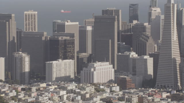 aerial transamerica pyramid rising above a crowded downtown, across from the coit tower / san francisco, california, united states - coit tower stock videos & royalty-free footage