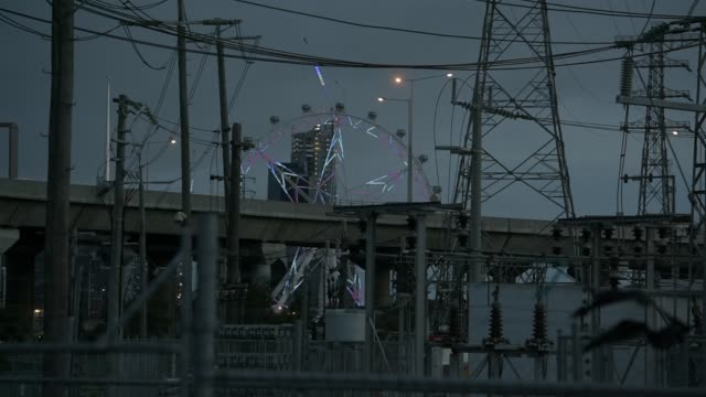 transfer station stands in the suburb of kensington at dusk in melbourne, australia, on friday, april 28 power lines frame the illuminated melbourne... - general view stock videos & royalty-free footage