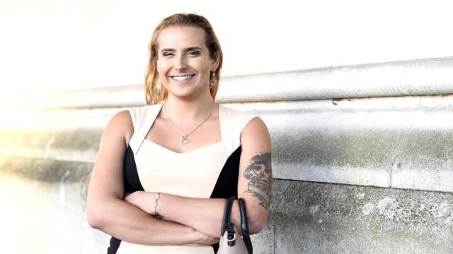 Transgender female portrait smiling to camera