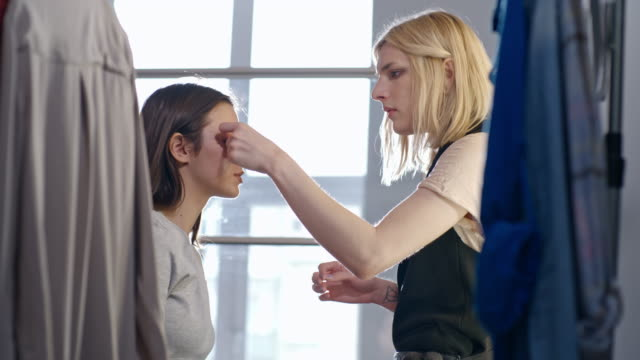 transgender make-up artist preparing fashion model for photo shoot - eyelid stock videos and b-roll footage