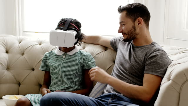 transgender male with his daughter using vr glasses - adoption stock videos and b-roll footage