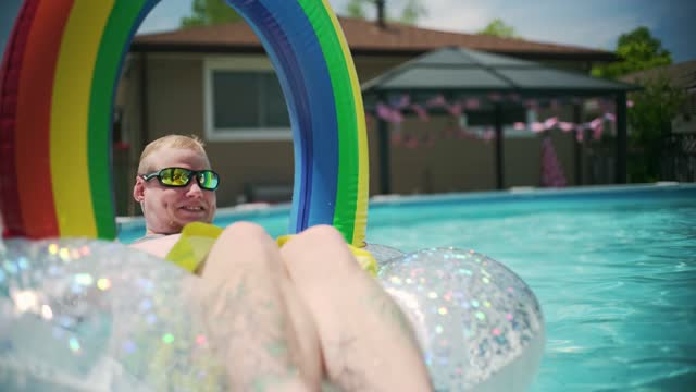 transgender man at the pool party in the backyard - spectrum stock videos & royalty-free footage