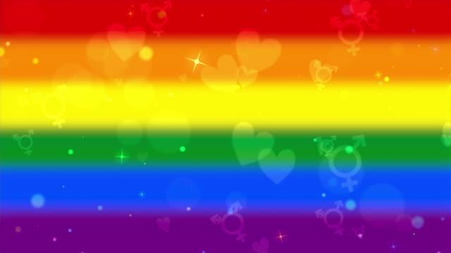 lgbt transgender symbols and hearts on rainbow gay pride flag looping background - abblenden stock-videos und b-roll-filmmaterial