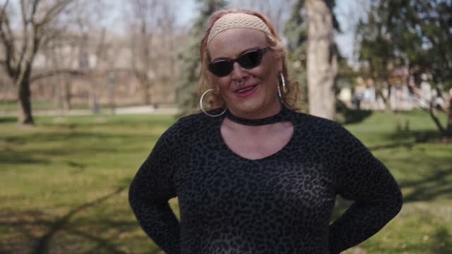 transgender woman walking the city park - pink hair stock videos & royalty-free footage