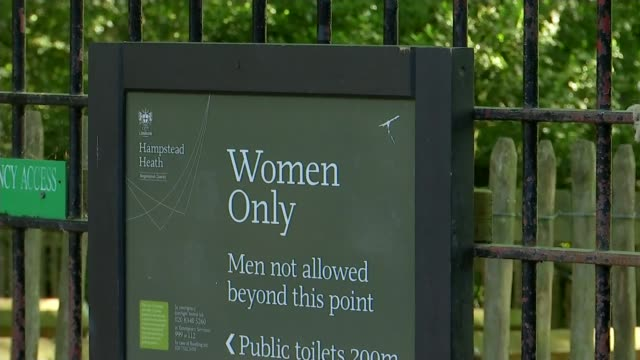 Transgender women's right to use Hampstead Heath ponds acknowledged ENGLAND London Hampstead Heath EXT Women entering and leaving gate to Kenwood...