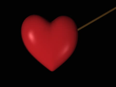 transition of a red heart being pierced by an arrow