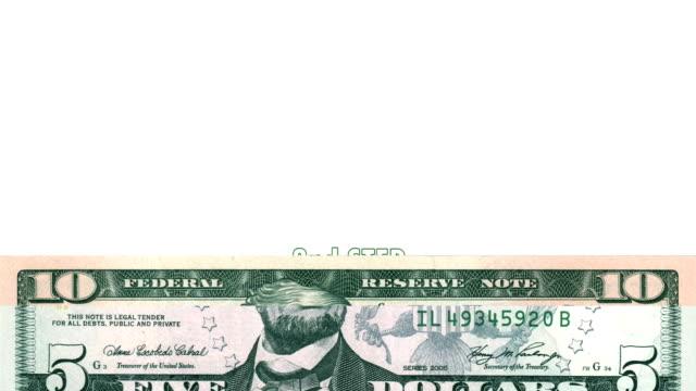 vídeos de stock e filmes b-roll de hd: transição com dólares bills - nota de cinco dólares dos estados unidos