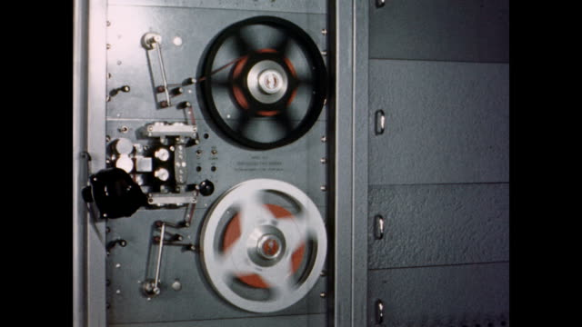 cu translation machine exterior / translation machine operating in empty room / cu of reels turning russian translation machine on september 01 1959 - cold war stock videos & royalty-free footage
