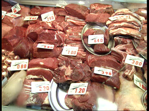 transmission to calves; transmission to calves; london seq staff at work in butcher's shop, meat displayed, female customer, brains in dish - biological process stock videos & royalty-free footage