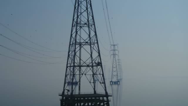 transmission towers on the sea of yeongheungdo island / ongjin-gun, incheon, south korea - power supply stock videos & royalty-free footage