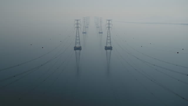transmission towers on the sea of yeongheungdo island / ongjin-gun, incheon, south korea - power line stock-videos und b-roll-filmmaterial