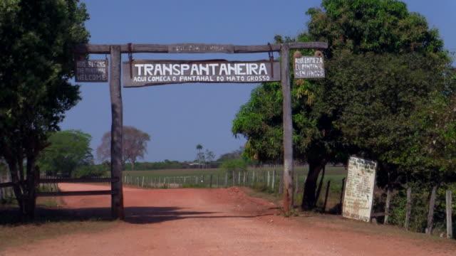 transpantaneria highway entrance, pantanal, brazi - 建物入口点の映像素材/bロール
