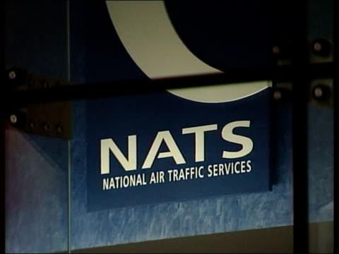 Air Traffic Control Crisis £30 Million Tax Loan Bailout ITN London Men away thru door of National Air Traffic Services headquarters building BV Men...
