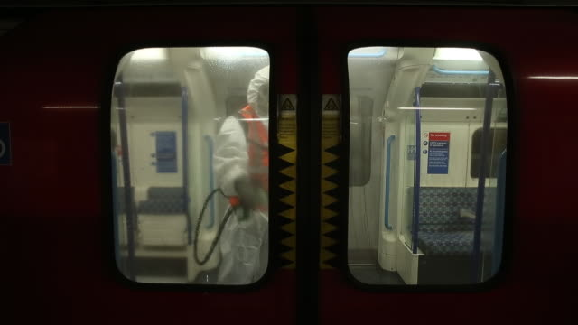 transport for london employees during a deep clean operation of a train used on the victoria line of london underground network, at the... - cleaning agent stock videos & royalty-free footage