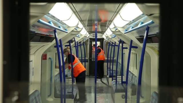 transport for london employees during a deep clean operation of a train used on the victoria line of london underground network, at the... - underground train stock videos & royalty-free footage