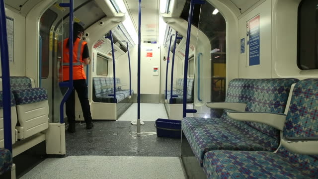 transport for london employees during deep clean operation of train used on the victoria line of london underground network, at the northumberland... - underground train stock videos & royalty-free footage