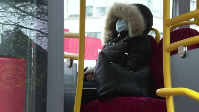transport for london london bus passenger wearing a face mask as a precautionary measure against covid19 drives their bus in london on april 6 as... - colleague stock videos & royalty-free footage