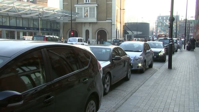 transport for london scraps proposed uber regulations england london ext various shots of minicabs in taxi rank queue with traditional black cabs... - taxi rank stock videos & royalty-free footage