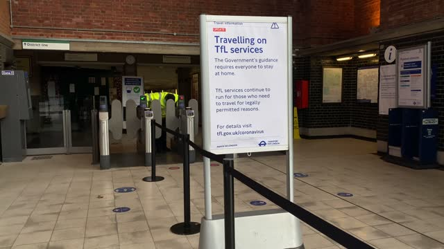 transport for london travel advisory at chiswick park station asking people to only use the london underground only if necessary as a cleaner... - document stock videos & royalty-free footage