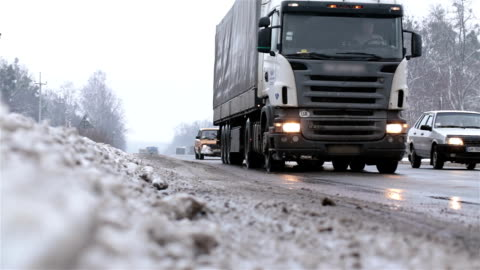 transport on the highway in winter. - slippery stock videos & royalty-free footage