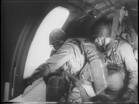 transport planes flying in formation / paratroopers inside plane attaching themselves to the rip chord / paratroopers looking out the open door of... - musical symbol stock videos & royalty-free footage