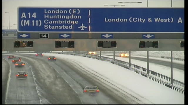 transport problems snowy scenes and children playing england london blackfriars ext/early morning gvs crashed car at side of snowy road as snow... - trolley bus stock videos & royalty-free footage