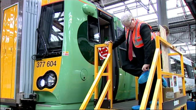 transport secretary vists new fleet of commuter trains in battersea england london battersea int patrick mcloughlin mp looking around inside carriage... - patrick mcloughlin stock videos and b-roll footage