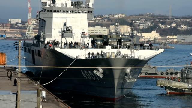 A transport vessel carrying groundbased ballistic missile interceptors left a Maritime SelfDefense Force base in Hiroshima Prefecture for Okinawa on...