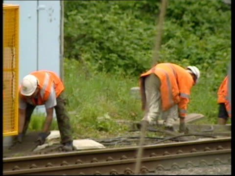 rail: potters bar train crash: maintenance company alleges sabotage; itn england: hertfordshire: potters bar: ext jarvis rail engineers wearing... - sabotage stock videos & royalty-free footage