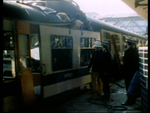 train crash england sheffield coaches of train to wrecked section ms 2 firemen clearing roof ms firemen and police by train ms zoom wreckage ms... - train crash stock videos and b-roll footage