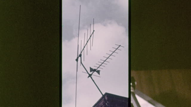 montage transportation and noise of modern life, with a radio and record player, antenna atop a house, cars on the freeway, airliner landing, and train on the tracks / united kingdom - radio stock videos and b-roll footage