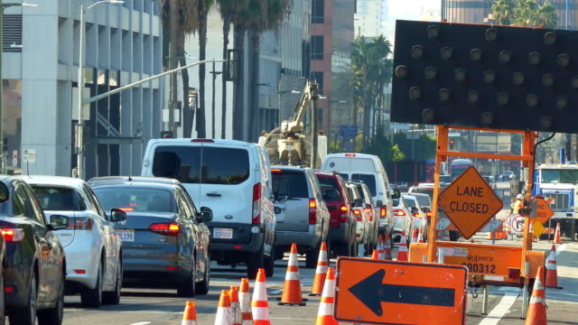 transportation collapse and heavy traffic jam congestion during rush hour due to the road construction in los angeles, california, 4k - motorway stock videos & royalty-free footage