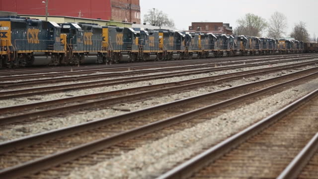 transportation, inc. freight train locomotives are pictured in a rail yard in bowling green, kentucky, u.s., on friday, april 13, 2018. - 貨物列車点の映像素材/bロール