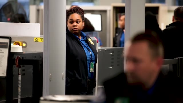 transportation security administration workers screen passengers and airport employees at o'hare international airport on january 07, 2019 in... - government shutdown stock videos & royalty-free footage