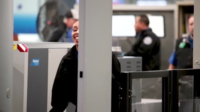 Transportation Security Administration workers screen passengers and airport employees at O'Hare International Airport on January 07 2019 in Chicago...