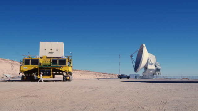 ws a transporter and one of the alma antennas / san pedro de atacama, chile - atacama large millimeter array stock videos and b-roll footage